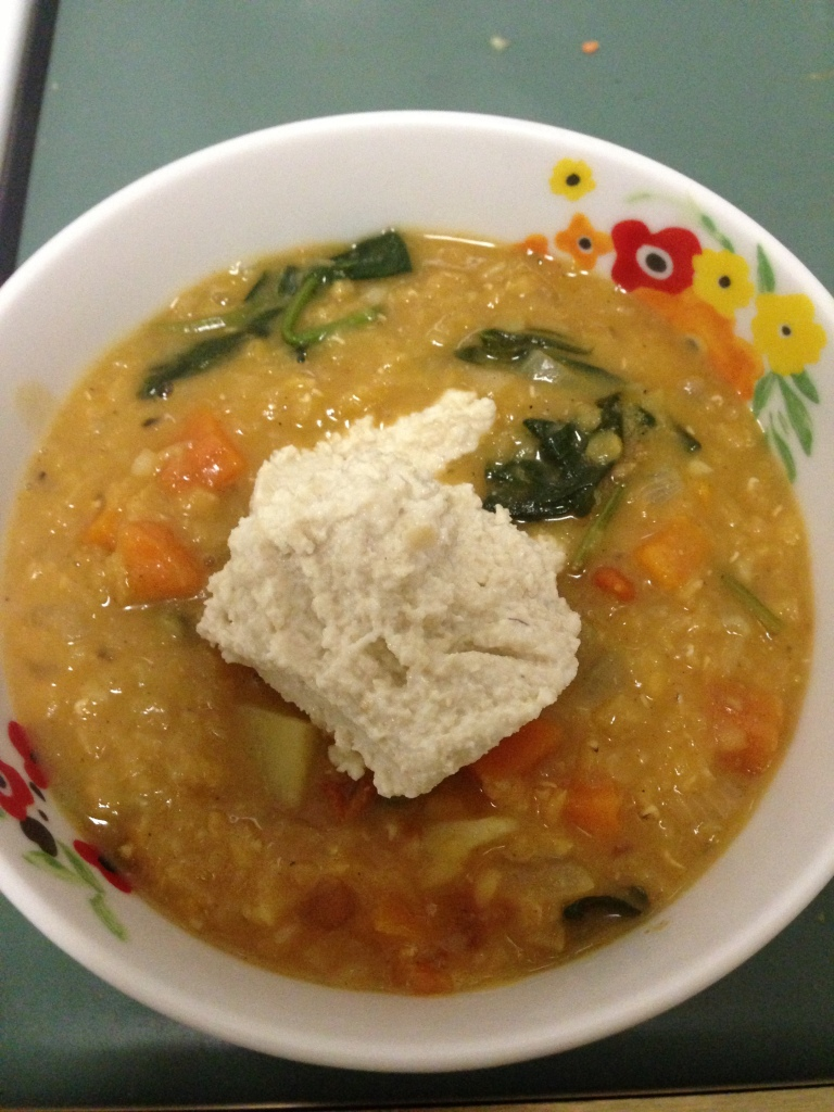Curried red lentil soup with cashew sour cream